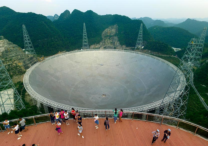 Tourists visit the Five-hundred-meter Aperture Spherical Telescope (FAST) in Pingtang, Guizhou province, Sept. 24, 2016. Wu Dongjun/VCG