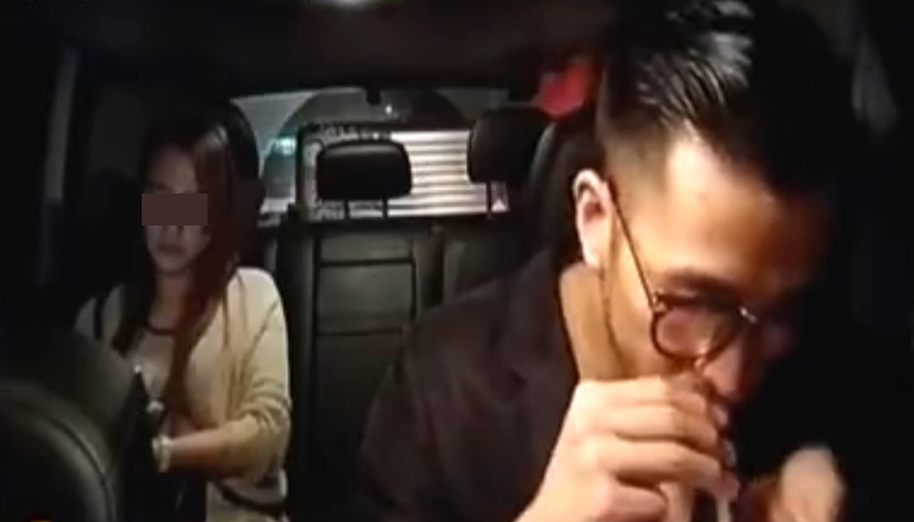 A screenshot from a CCTV report shows a broadcaster surnamed Huang (right) pretending to take drugs on a live stream. Huang was later detained by Shanghai police.