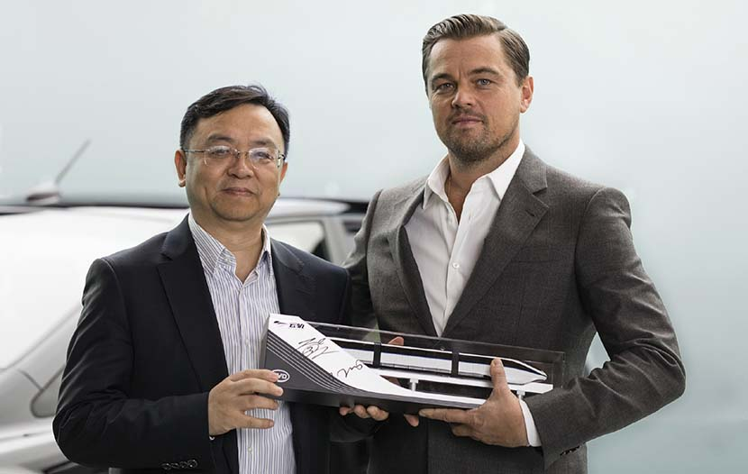 Leonardo DiCaprio shakes hands with Wang Chuanfu (left), the chairman of BYD Auto, after the actor was announced as the brand ambassador for BYD's new-energy cars, Dec. 16, 2016. From BYD's official Weibo account
