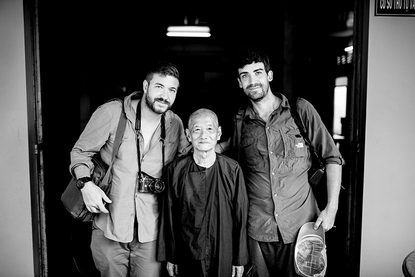 Photographers Gareth Bright (left) and Luc Forsyth (right) pose with an elderly man they met on the journey. Courtesy of Luc Forsyth
