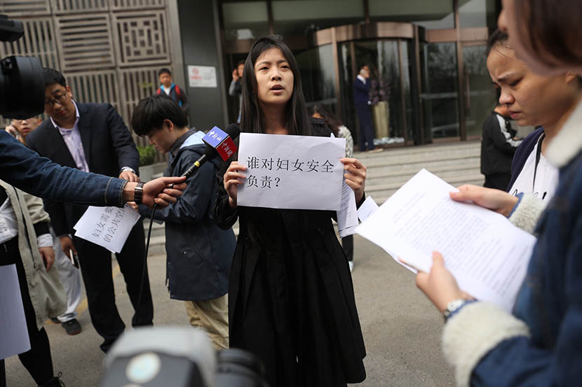 A woman holds a sign, the meaning of which translates to, 'Who will be responsible for women safety?' in a protest in front of the Yitel hotel in Beijing, April 6, 2016. Li Kun/Sixth Tone