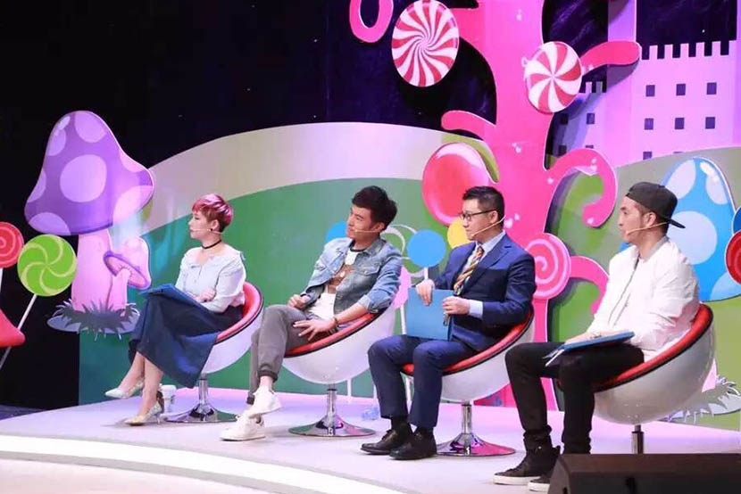 Presenters Tang Zhizhong, Geng Le (Blued founder), Geng Le (Chinese actor), and Wang Meng (right to left) sit on stage during the filming of 'Call Me Maybe.' From Geng Le's Weibo account.